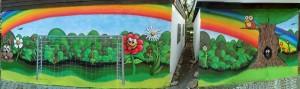 Graffiti am Erich-Kästner-Haus in Gelsenkirchen Erle Regenbogen Blumen Berge Tor